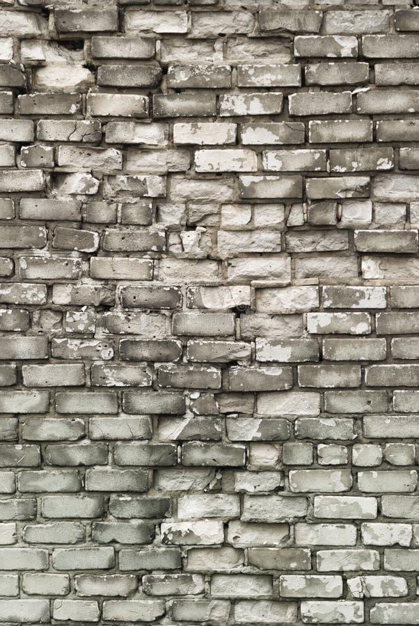 Textuur van oude bakstenen muur met het gebarsten doorstane close-up van de structuur witte grijze kleur stock afbeelding