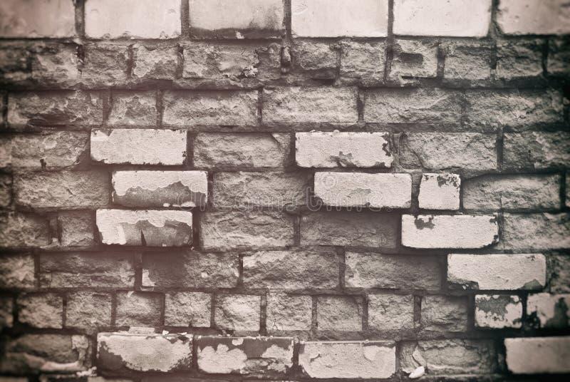 Textuur van oude bakstenen muur met het gebarsten doorstane close-up van de structuur witte grijze kleur stock fotografie