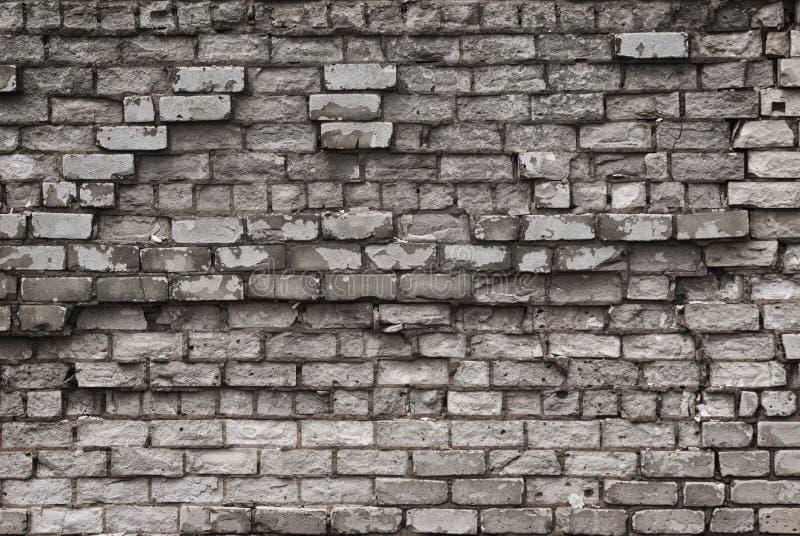 Textuur van oude bakstenen muur met het gebarsten doorstane close-up van de structuur witte grijze kleur royalty-vrije stock foto