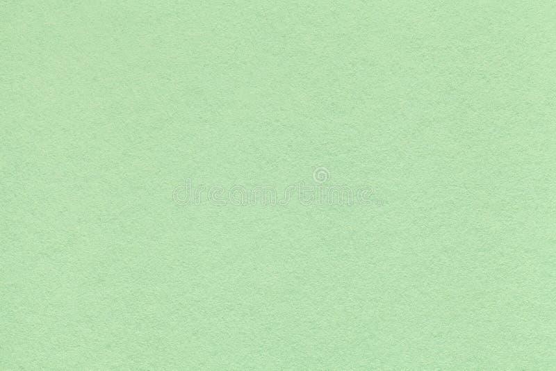 Textuur van oude lichtgroene document close-up Structuur van een dicht karton De muntachtergrond royalty-vrije stock foto's