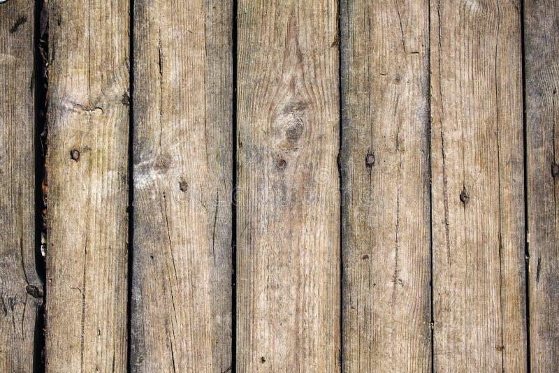Textuur van raad met barsten en spijkerhoofden stock fotografie