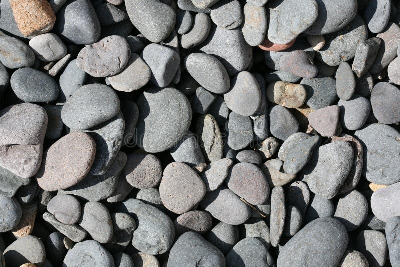 Textuur van rotsenstrand stock foto's