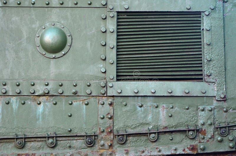 Textuur van tankzijgevel, van metaal wordt en met een massa bouten en klinknagels wordt versterkt gemaakt die die stock foto's