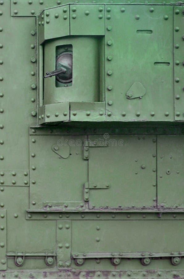 Textuur van tankzijgevel, van metaal wordt en met een massa bouten en klinknagels wordt versterkt gemaakt die die stock afbeeldingen