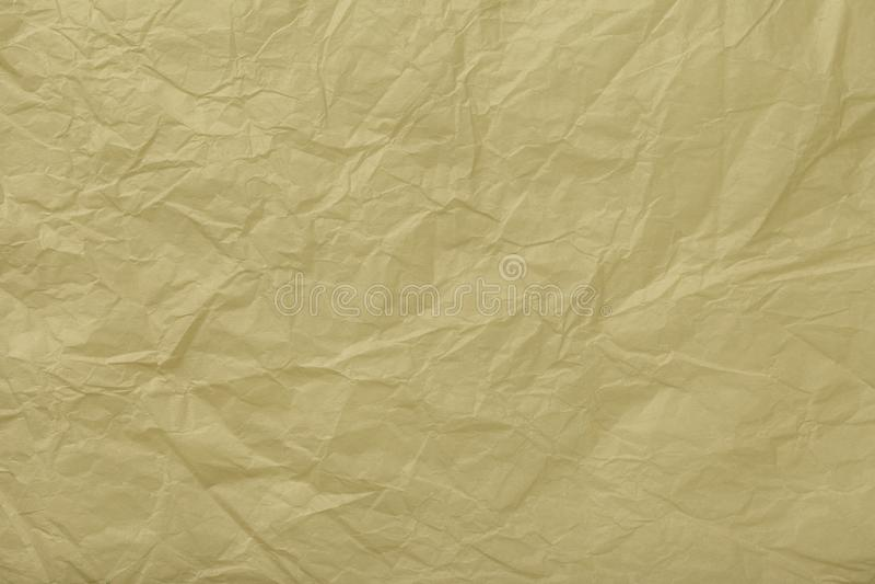 Textuur van verfrommeld beige verpakkend document, close-up Gouden oude achtergrond stock fotografie