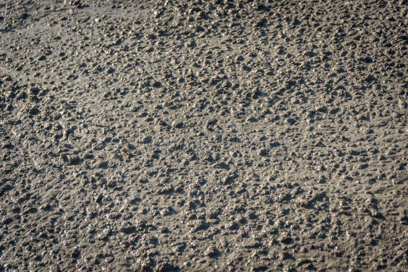 Textuur van vloeibaar die beton met zand wordt gemengd stock foto