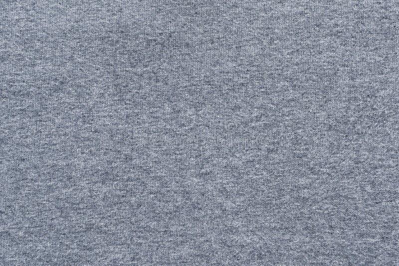 Textuur van zachte gebreide stoffen witte blauwe kleur stock foto