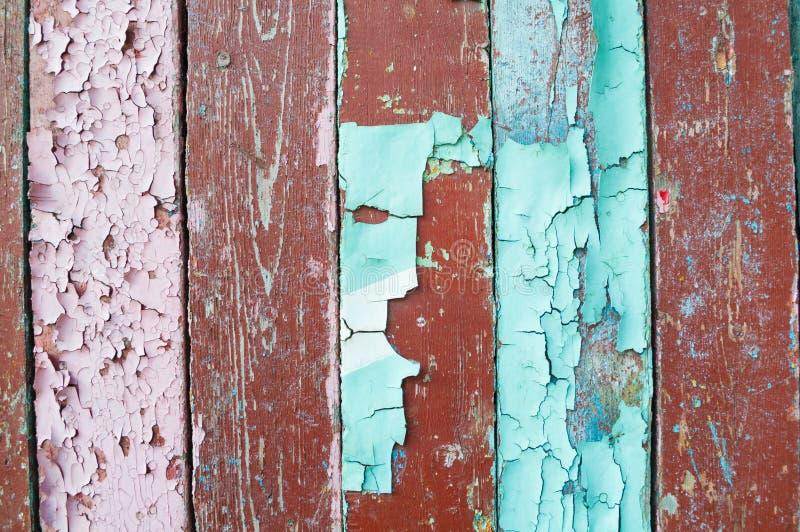 Textuurachtergrond - oude geschilderde houten oppervlakte met schil blauwe en bruine verf royalty-vrije stock afbeelding