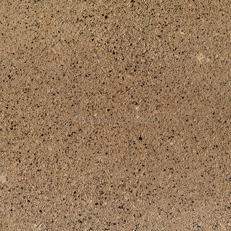 Textuurachtergrond van samengestelde stenen gelijkend op bruin graniet stock afbeelding