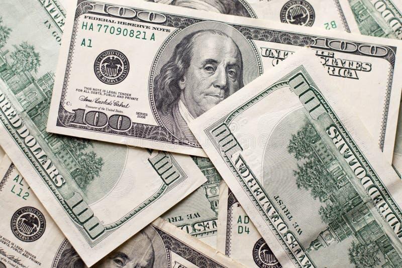 Textuuramerikaanse dollars Achtergrond van honderd dollarsrekeningen stock afbeelding