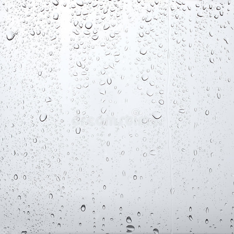 Textuurdalingen van water op het transparante glas, abstracte achtergrond stock afbeeldingen