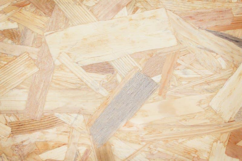 Textuurfragment van een hout van het plaatafval, triplex abstracte achtergrond, natuurlijk patronen recycling royalty-vrije stock afbeelding