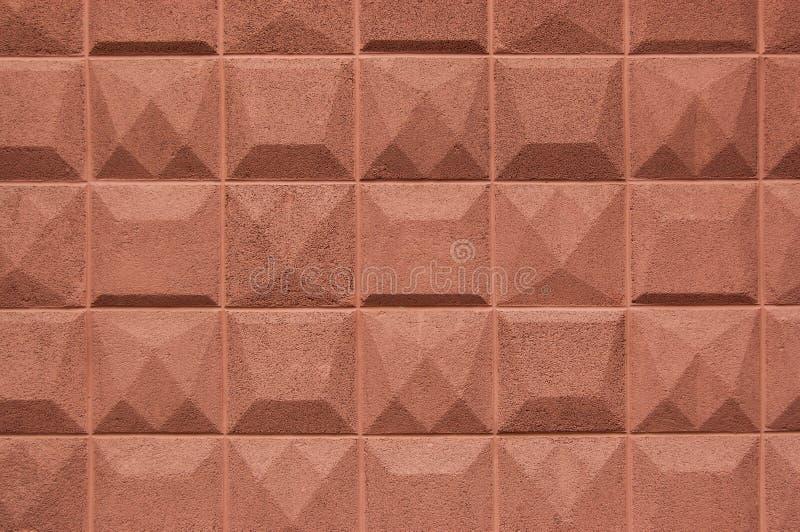 Textuurmuur met vierkante plakken van crumbs baksteenkleur kunstmatig royalty-vrije stock afbeelding