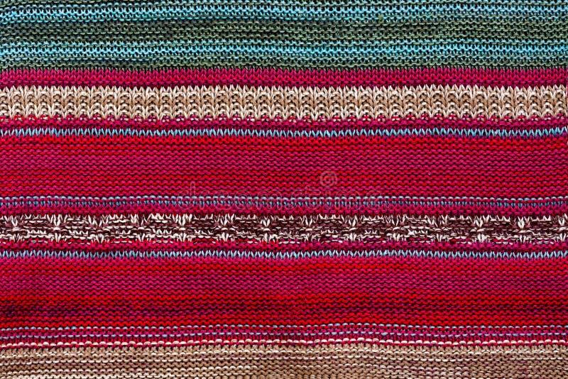 Textuurstof met gestreept helder patroon Kerstmis Scrapbooking Gebreide achtergrond Deken, het breien, lijnen, royalty-vrije stock afbeelding