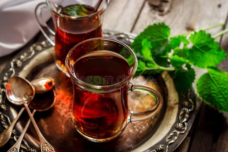 Thé avec la menthe image stock