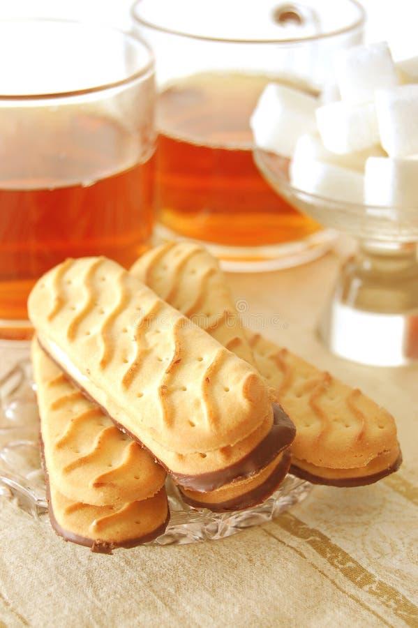 Thé avec les biscuits doux images libres de droits