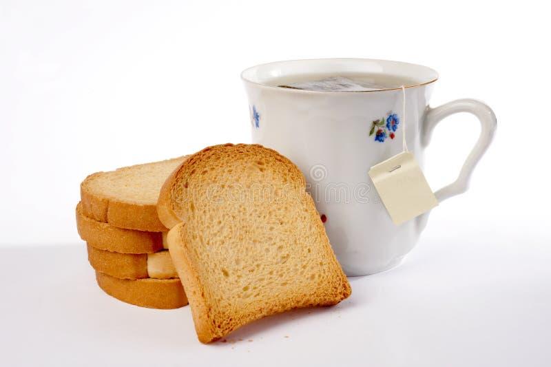 Thé et biscottes images stock
