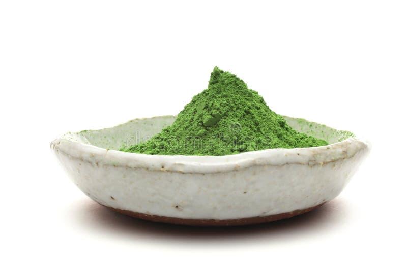 Thé vert en poudre photos stock