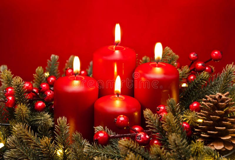 4th Advent red candle flower arrangement royalty free stock photos