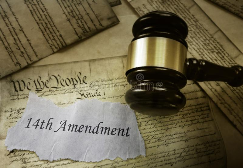 Fourteenth Amendment concept. 14th Amendment news headline on pages of the US Consitution royalty free stock photo