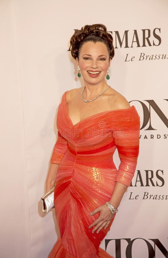 68th Annual Tony Awards. TV sitcom queen Fran Drescher arrives on the red carpet wearing a tangerine ruched mermaid gown an Verdura platinum and diamond bracelet royalty free stock images
