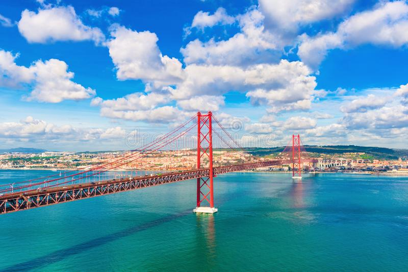The 25th April Bridge Ponte 25 de Abril between Lisbon and Almada, Portugal. One of the longest suspension bridges in Europe.  stock photography