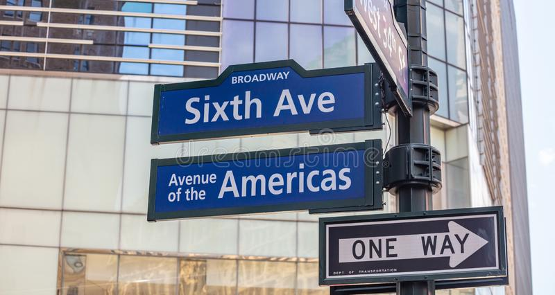 6th ave, Broadway Manhattan New York downtown. Blue color street signs. Sixfth ave Broadway street sign, Manhattan New York downtown. Blue signs on blur stock photography