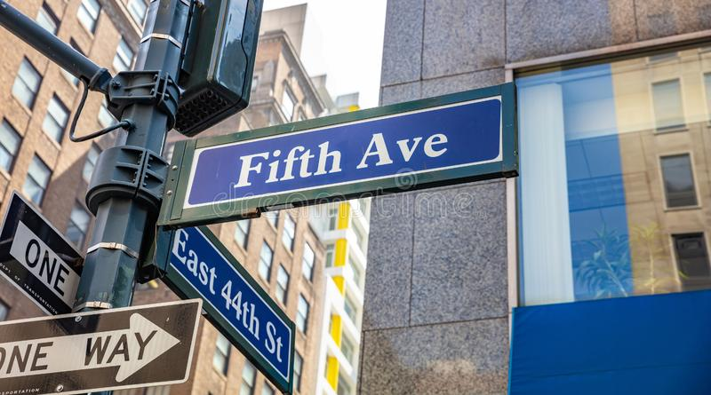 5th ave and E44 corner. Blue color street signs, Manhattan New York downtown. Fifth ave and East 44th crossroads street signs, Manhattan New York downtown. Blur stock photography