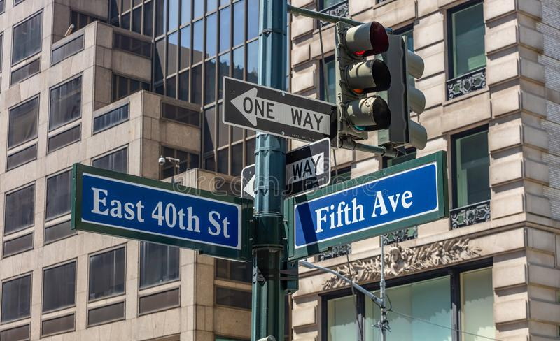 5th ave and E40 corner. Blue color street signs, Manhattan New York downtown. Fifth ave and East 40th crossroads street signs, Manhattan New York downtown. Blur royalty free stock images