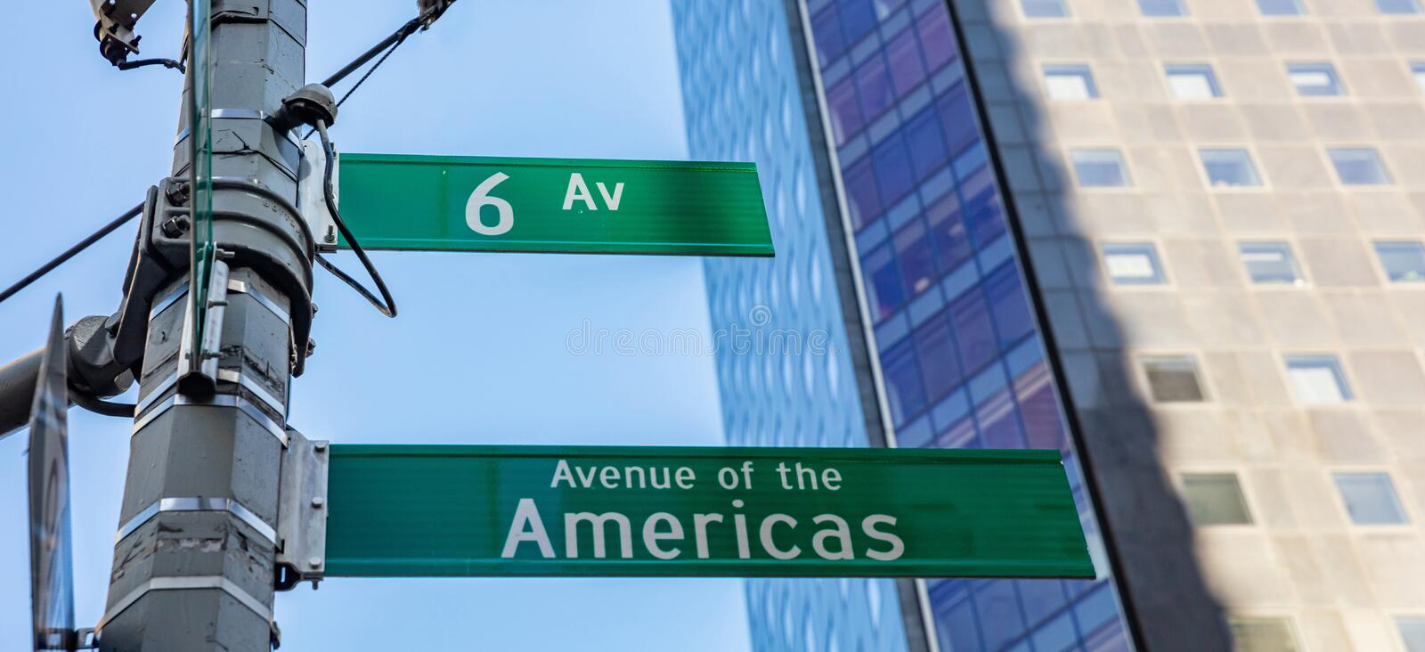 6th ave, Manhattan New York downtown. Green color street signs. Sixfth ave street sign, Manhattan New York downtown. Green signs on blur buildings facade and royalty free stock photo