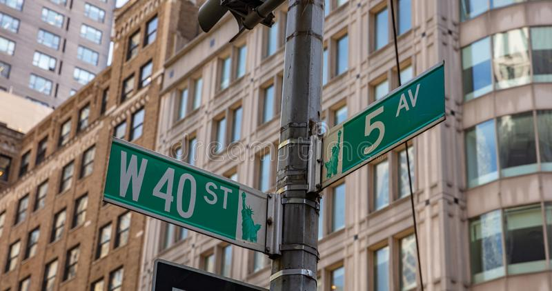 5th ave and W40 corner. Green color street signs, Manhattan New York downtown. Fifth ave and West 40th crossroads street signs, Manhattan New York downtown. Blur royalty free stock photos