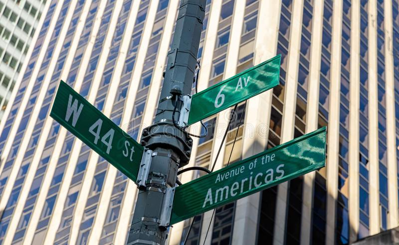 6th ave and W44, Manhattan New York downtown. Green color street signs. Sixfth ave and West 44 crossroads street sign, Manhattan New York downtown. Green signs royalty free stock photography
