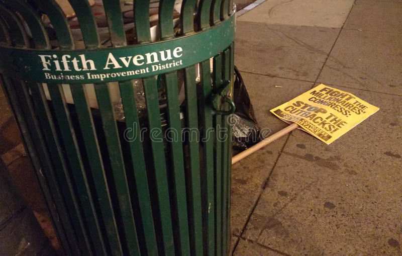 5th Avenue Business Improvement District, Political Protest Sign Near The Garbage, NYC, NY, USA stock images