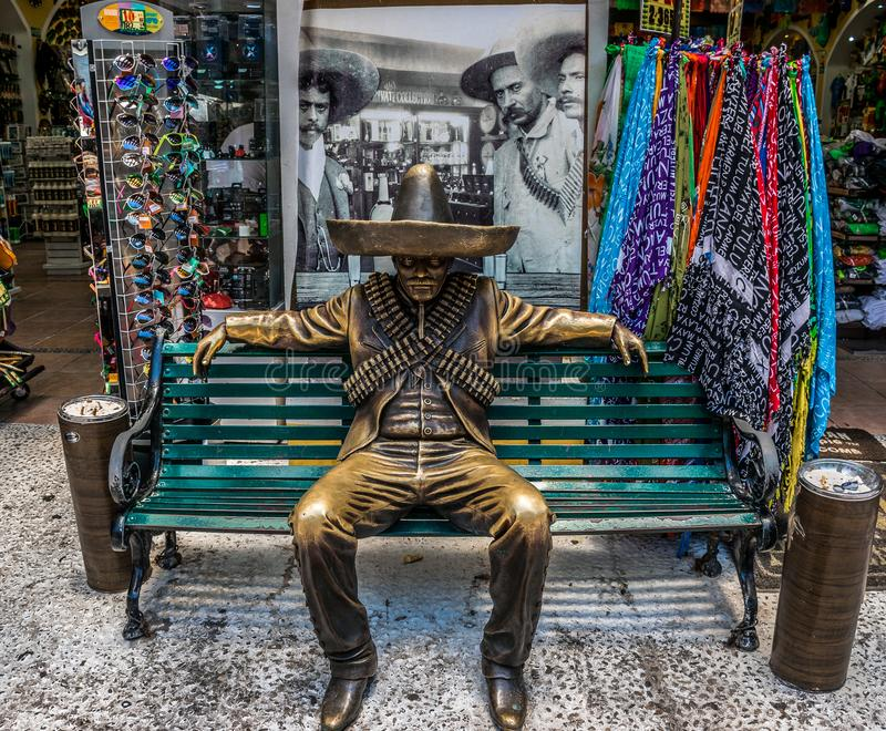 5th Avenue Mexican Gunslinger Statue in Front of Hacienda Tequila in Playa Del Carmen, Mexico royalty free stock images