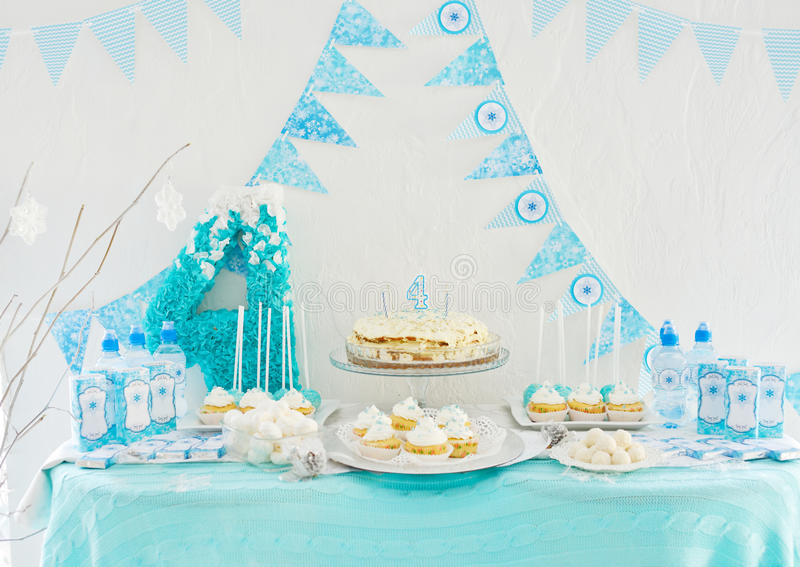 4th birthday. Cake, candies, marshmallows, cakepops for 4th birthday party, focus on candle stock image
