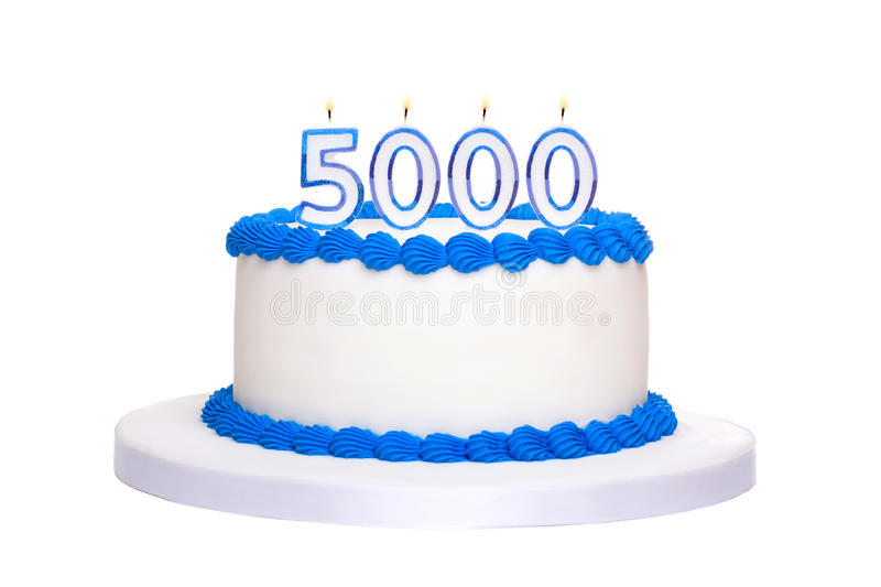 5000th birthday cake. Birthday cake with candles reading 5000 stock image