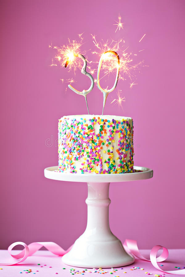 30th birthday cake. With sparklers stock images