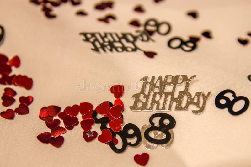 60th Birthday Confetti. Confetti for 60th birthday on white table cloth stock photography