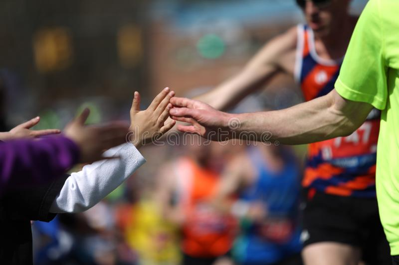 118th Boston Marathon took place in Boston, Massachusetts, on Monday, April 21 Patriots` Day 2014. High Five. 118th Boston Marathon took place in Boston royalty free stock images