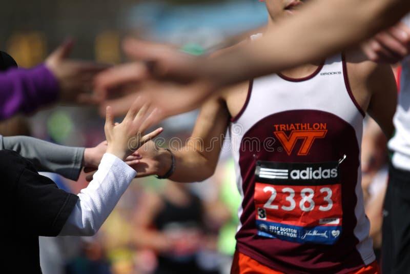 118th Boston Marathon took place in Boston, Massachusetts, on Monday, April 21 Patriots` Day 2014. High Five. 118th Boston Marathon took place in Boston royalty free stock photos