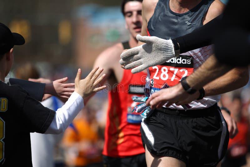 118th Boston Marathon took place in Boston, Massachusetts, on Monday, April 21 Patriots` Day 2014. High Five. 118th Boston Marathon took place in Boston stock images