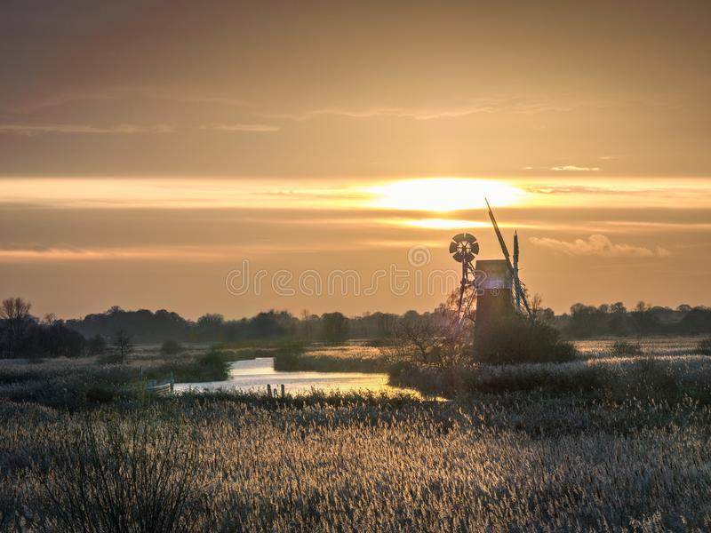 Turf fen drainage mill - sunset. The 19th century drainage mill at Turf Fen is one of the Norfolk Broad`s most iconic sights. The mill only accessible by boat stock photo