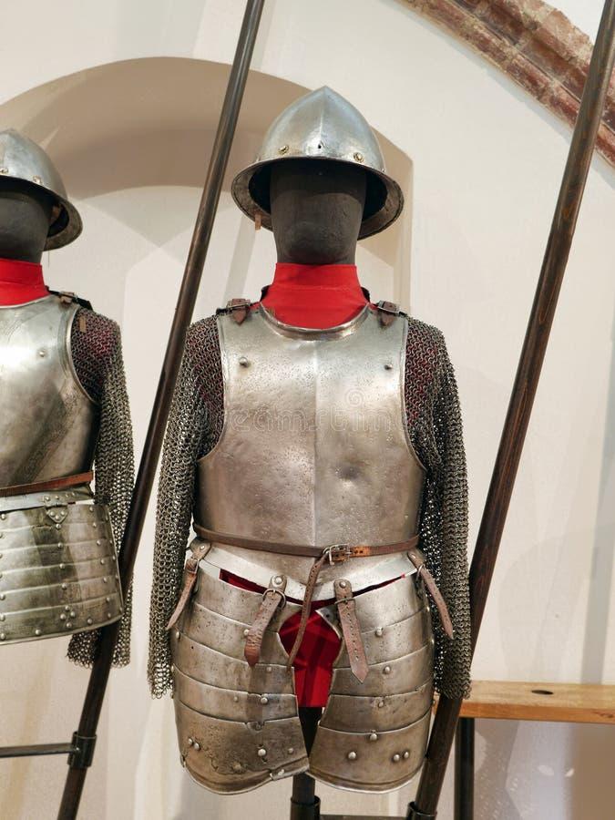 17th century European armour exhibited in Malbork castle museum, Poland. MALBORK, POLAND - 15 AUGUST, 2013: 17th century European armour and pike exhibited in stock photos