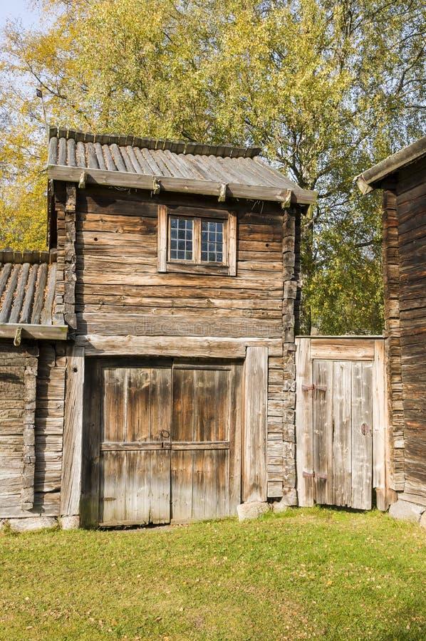 17th-century farmbuilding Delsbo. 17th-century farmbuilding named Tjarnmyra cottage (Swedish: Tjärnmyrastugan) with a so called maid loft at Delsbo homestead stock photography