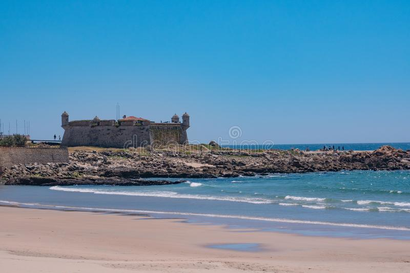 17th century fort in Porto, Portugal known as Castelo do Queijo. Viewed over beach. 17th century fort in Porto, Portugal known as Castelo do Queijo. Viewed over stock image
