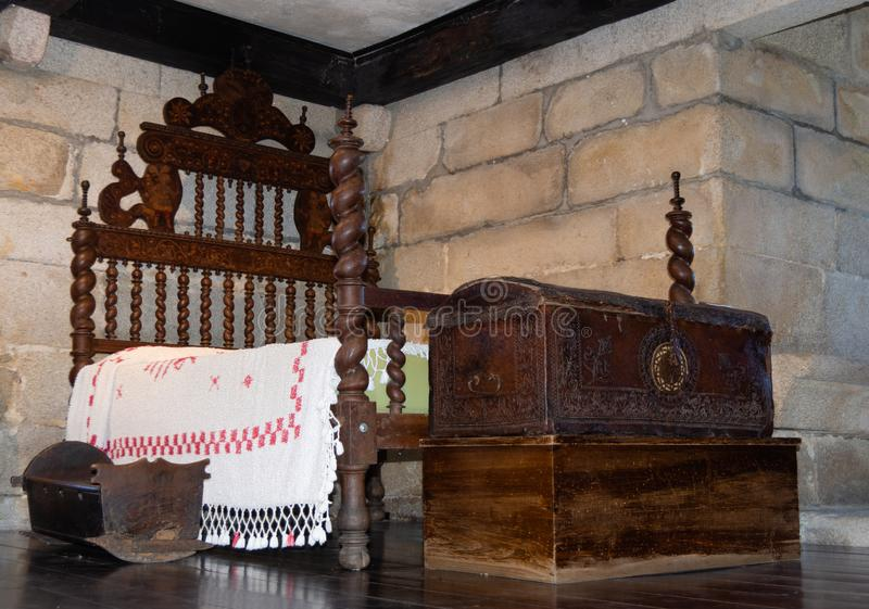 17th century furniture. Made up of a bed, a crib and some trunks to store clothes royalty free stock photos