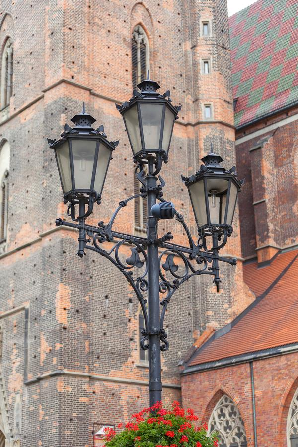 14th century gothic St. Elisabeth Church, street lamp, Market Square, Wroclaw, Poland stock photography