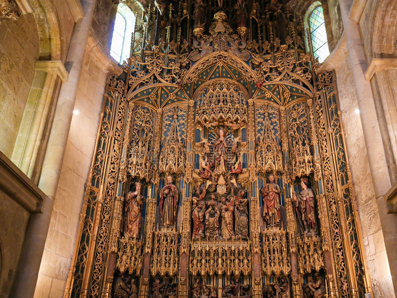 15th century retable in Coimbra Old Cathedral or Se Velha. Magnificent 15th Century retable in the Old Cathedral or Se Velha of Coimbra, Portugal, created by royalty free stock photography
