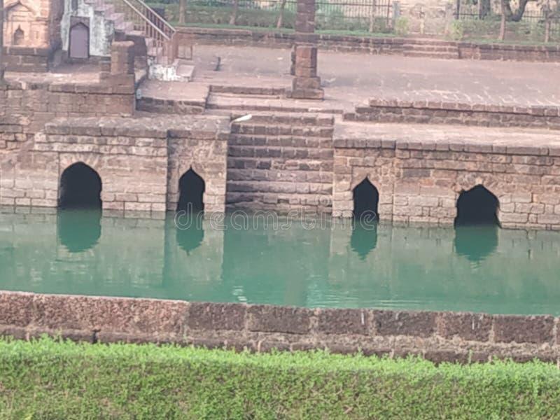 15th century Safa Masjid, in Goa, India. 15th century Saga Masjid, in Goa, India. The masjid is surrounded by lush greenery and a beautiful pond royalty free stock photos