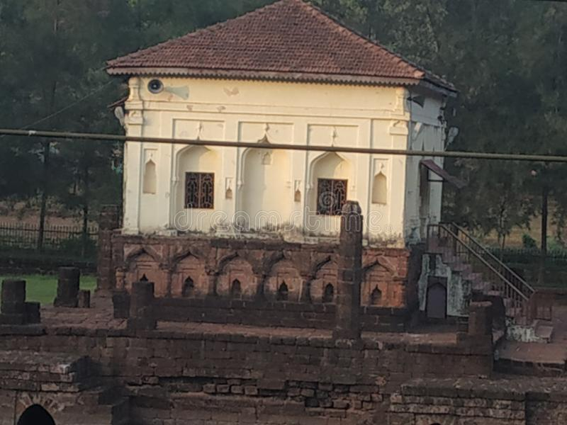 15th century Safa Masjid, in Goa, India. 15th century Saga Masjid, in Goa, India. The masjid is surrounded by lush greenery and a beautiful pond royalty free stock image